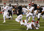 UNLV Rebels quarterback Max Gilliam avoids a tackle by Fresno State Bulldogs defensive tackle Kevin Atkins (90) during the first half of an NCAA college football game Saturday, Nov. 3, 2018, in Las Vegas. (AP Photo/John Locher)