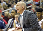 Louisville head coach Chris Mack shouts instructions to his team during the first half of an NCAA college basketball game against Miami in Louisville, Ky., Sunday, Jan. 6, 2019. (AP Photo/Timothy D. Easley)