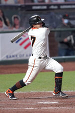 San Francisco Giants' Donovan Solano (7) hits a single to drive in a run against the Colorado Rockies during the fifth inning of a baseball game on Monday, Sept. 21, 2020, in San Francisco. (AP Photo/Tony Avelar)