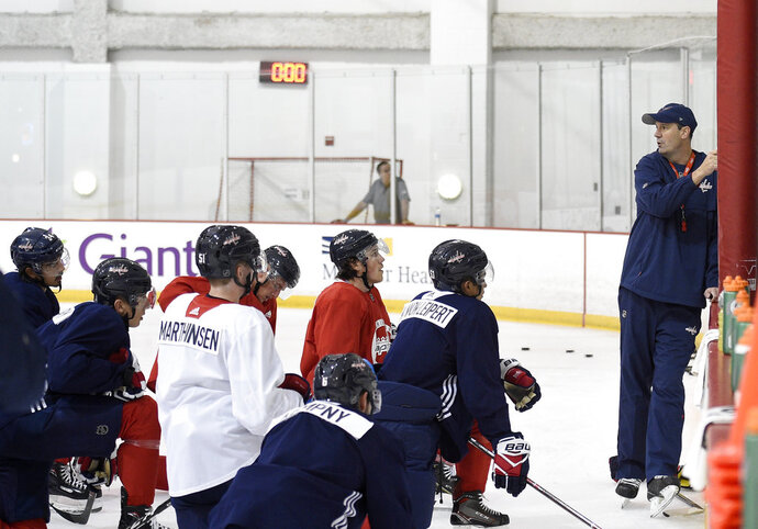 Washington Capitals head coach Todd Reirden, right, speaks to his players during NHL hockey training camp, Friday, Sept. 14, 2018, in Arlington, Va. (AP Photo/Nick Wass)