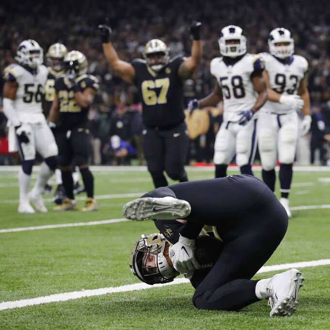 New Orleans Saints' Garrett Griffin catches a touchdown pass during the first half of the NFL football NFC championship game against the Los Angeles Rams, Sunday, Jan. 20, 2019, in New Orleans. (AP Photo/Carolyn Kaster)