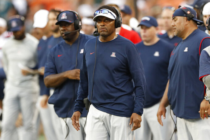 Arizona head coach Kevin Sumlin, center, is seen on the sidelines during an NCAA college football game against Hawaii, Saturday, Aug. 24, 2019, in Honolulu. (AP Photo/Marco Garcia)