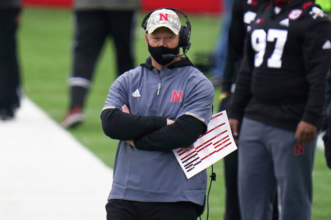 Nebraska head coach Scott Frost follows the first half of an NCAA college football game against Illinois in Lincoln, Neb., Saturday, Nov. 21, 2020. (AP Photo/Nati Harnik)