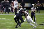 New Orleans Saints quarterback Taysom Hill (7) passes under pressure from Atlanta Falcons defensive end Steven Means (55)in the first half of an NFL football game in New Orleans, Sunday, Nov. 22, 2020. (AP Photo/Brett Duke)
