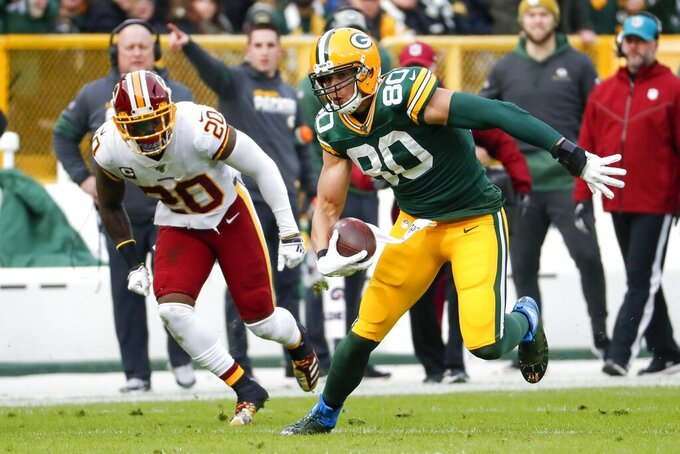 Green Bay Packers' Jimmy Graham runs past Washington Redskins' Landon Collins after a catch during the first half of an NFL football game Sunday, Dec. 8, 2019, in Green Bay, Wis. (AP Photo/Matt Ludtke)
