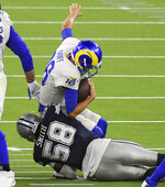 Dallas Cowboys defensive end Aldon Smith (58) sacks Los Angeles Rams quarterback Jared Goff (16) in the fourth quarter of an NFL football game, Sunday, Sept. 13, 2020, in Inglewood, Calif. (Keith Birmingham/The Orange County Register via AP)