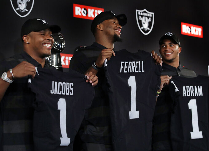 Oakland Raiders first-round NFL draft selections, from left to right, Josh Jacobs, Clelin Ferrell and Johnathan Abram hold jerseys after a football media conference Friday, April 26, 2019, in Alameda, Calif. (AP Photo/Ben Margot)