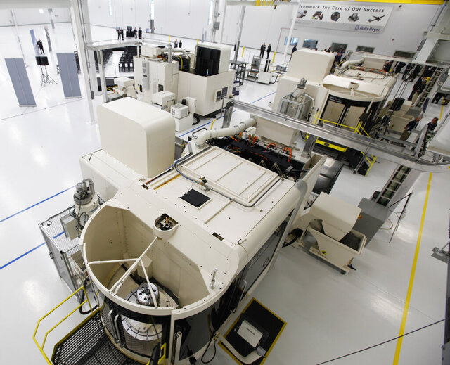 FILE - In this May 2, 2011, file photo, several computerized milling machines are set up at the Rolls-Royce Crosspointe manufacturing and research facility in Prince George, Va. The Rolls Royce plant in Virginia that builds turbine blades for jet engines laid off more than 100 workers earlier this year and plans to close the plant in June.  (AP Photo/Steve Helber, File)