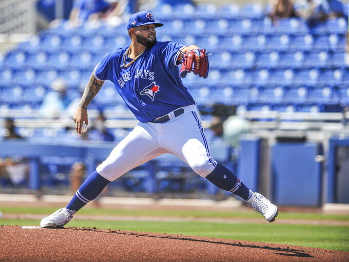 FILE - In this March 14, 2021, file photo, Toronto Blue Jays pitcher Alek Manoah throws to a New York Yankees batter during the first inning of a spring training baseball game in Dunedin, Fla. Manoah, a 23-year-old prospect, is being called up by the Blue Jays to make his major league debut against the New York Yankees on Wednesday night, May 26. (Steve Nesius/The Canadian Press via AP, File)