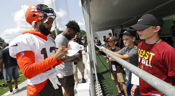 Cleveland Browns wide receiver Odell Beckham Jr. signs autographs after practice at the NFL football team's training camp facility, Thursday, July 25, 2019, in Berea, Ohio. (AP Photo/Tony Dejak)