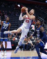 Detroit Pistons forward Blake Griffin (23) makes a layup as Minnesota Timberwolves forward Robert Covington (33) defends during the first half of an NBA basketball game, Monday, Nov. 11, 2019, in Detroit. (AP Photo/Carlos Osorio)