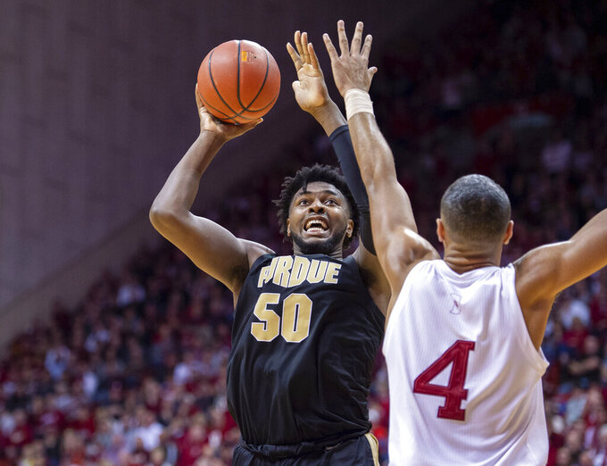 Purdue forward Trevion Williams (50) shoots the ball as Indiana forward Trayce Jackson-Davis (4) defends during the second half of an NCAA college basketball game, Saturday, Feb. 8, 2020, in Bloomington, Ind. Purdue won 74-62. (AP Photo/Doug McSchooler)