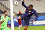 France's Kylian Mbappe challenges Portugal goalkeeper Rui Patricio, left, during the UEFA Nations League soccer match between France and Portugal at the Stade de France in Saint-Denis, north of Paris, France, Sunday, Oct. 11, 2020. (AP Photo/Thibault Camus)