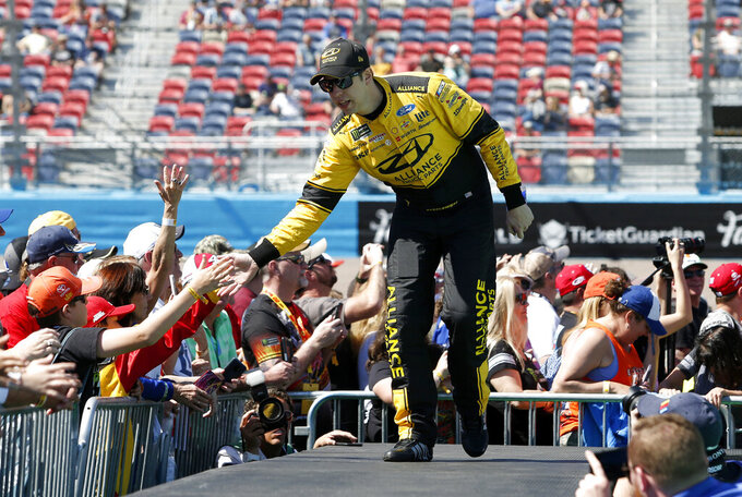 Brad Keselowski is greeted by fans during driver introductions prior to the start of the NASCAR Cup Series auto race at ISM Raceway, Sunday, March 10, 2019, in Avondale, Ariz. (AP Photo/Ralph Freso)