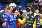 Scott Dixon, of New Zealand, talks with Colton Herta after Dixon won the pole for the Indianapolis 500 auto race at Indianapolis Motor Speedway, Sunday, May 23, 2021, in Indianapolis. (AP Photo/Darron Cummings)