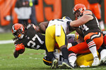 Cleveland Browns running back Kareem Hunt (27) stretches for yardage during the second half of an NFL football game against the Pittsburgh Steelers, Sunday, Jan. 3, 2021, in Cleveland. (AP Photo/Ron Schwane)