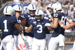 Penn State running back Ricky Slade (3) celebrates his first quarter touchdown against Idaho in a NCAA college football game in State College, Pa., on Saturday, Aug. 31, 2019. (AP Photo/Barry Reeger)