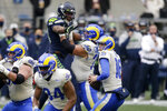 Los Angeles Rams quarterback Jared Goff (16) looks for room to pass against the Seattle Seahawks during the first half of an NFL wild-card playoff football game, Saturday, Jan. 9, 2021, in Seattle. (AP Photo/Scott Eklund)