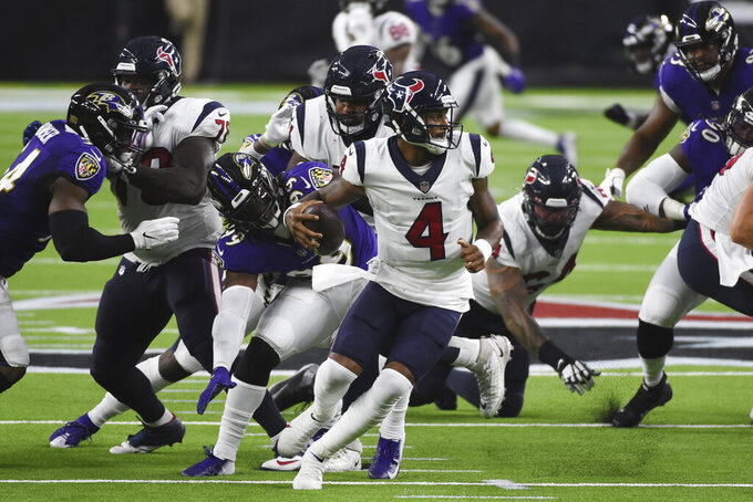 Houston Texans quarterback Deshaun Watson (4) scrambles during the first half of an NFL football game against the Baltimore Ravens Sunday, Sept. 20, 2020, in Houston. (AP Photo/Eric Christian Smith)
