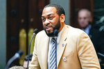 """FILE - In this Feb. 19, 2020, file photo, state Rep. Charles Booker advocates for the passage of Kentucky HB-12 on the floor of the House of Representatives in the State Capitol in Frankfort, Ky. Ex-Marine pilot Amy McGrath, who seemed to be gliding toward a primary victory in Kentucky, has come under heavy fire from both directions in the closing days of the Democratic contest to determine who challenges Republican Senate Majority Leader Mitch McConnell in the fall. Booker recently released his first TV ad that says a """"real Democrat"""" is needed to take the fight to McConnell, the top-ranking congressional Republican who is seeking a seventh term. (AP Photo/Bryan Woolston, File)"""