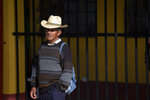 A man waits to casts his votes at a polling station in Sumpango, Guatemala, Sunday, June 16, 2019. Guatemalans are voting for their next president Sunday in elections plagued by widespread disillusion and distrust, and as thousands of their compatriots flee poverty and gang violence to seek a new life in the United States. (AP Photo/Moises Castillo)