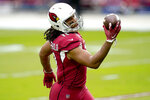 Arizona Cardinals wide receiver Larry Fitzgerald (11) warms up prior to an NFL football game against the Detroit Lions, Sunday, Sept. 27, 2020, in Glendale, Ariz. (AP Photo/Ross D. Franklin)