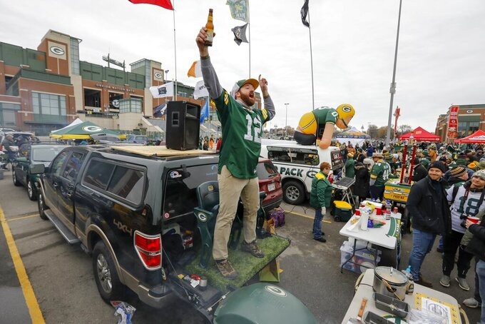 Jon Eisele tailgates before an NFL football game between the Green Bay Packers and the Carolina Panthers Sunday, Nov. 10, 2019, in Green Bay, Wis. (AP Photo/Mike Roemer)
