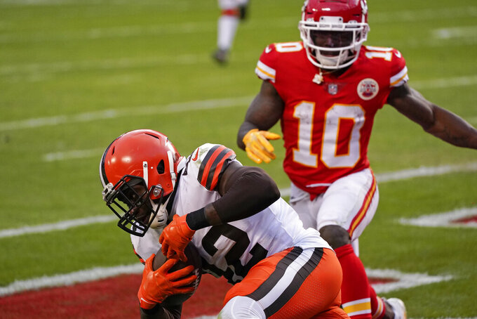 Cleveland Browns safety Karl Joseph intercepts a pass in the end zone in front of Kansas City Chiefs wide receiver Tyreek Hill (10) during the second half of an NFL divisional round football game, Sunday, Jan. 17, 2021, in Kansas City. (AP Photo/Charlie Riedel)
