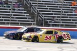 Justin Allgaier, left, and Kyle Busch (54) race down the front stretch late in a NASCAR Xfinity Series auto race at Texas Motor Speedway in Fort Worth, Texas, Saturday, June 12, 2021. (AP Photo/Larry Papke)