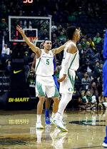 Oregon Ducks guard Chris Duarte (5), celebrates a three pointer against Boise State in an NCAA college basketball game Saturday, Nov. 9, 2019, in Eugene, Ore. (AP Photo/Thomas Boyd)