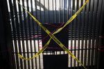 Precaution tape covers an entrance to the Senate, placed by demonstrators protesting against Mexican President Andres Manuel Lopez Obrador's effort to eliminate trust funds which he says are sources of corruption in Mexico City, Wednesday, Oct. 21, 2020. The Senate passed various laws on Wednesday eliminating over 100 trusts which finance everything from science to movie productions to disaster relief. (AP Photo/Fernando Llano)
