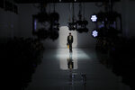 A model wears a creation as part of the Fendi men's Fall-Winter 2020/21 collection, that was presented in Milan, Italy, Monday, Jan. 13, 2020. (AP Photo/Antonio Calanni)