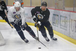 Pittsburgh Penguins' Evgeni Malkin, left, takes the puck from David Warsovsky during NHL hockey practice on the team's first day of training camp, Friday, Sept. 13, 2019, in Cranberry Township, Butler County, Pa. (AP Photo/Keith Srakocic)
