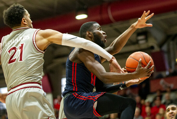 Dayton guard Jalen Crutcher (10) moves to the basket past Saint Joseph's forward Lorenzo Edwards (21) during the first half of an NCAA college basketball game, Sunday, Jan. 5, 2020, in Philadelphia. (AP Photo/Laurence Kesterson)