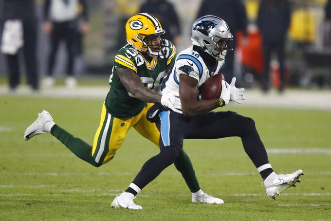 Green Bay Packers' Chandon Sullivan tries to stop Carolina Panthers' Curtis Samuel during the first half of an NFL football game Saturday, Dec. 19, 2020, in Green Bay, Wis. (AP Photo/Matt Ludtke)