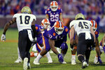 FILE - In this Nov. 2, 2019, file photo, Clemson's Tremayne Anchrum (73) sets to block while B.T. Potter (29) prepares to kick a filed goal during the second half of an NCAA college football game against Wofford, in Clemson, S.C. Anchrum was selected to The Associated Press All-Atlantic Coast Conference football team, Tuesday, Dec. 10, 2019. (AP Photo/Richard Shiro, File)
