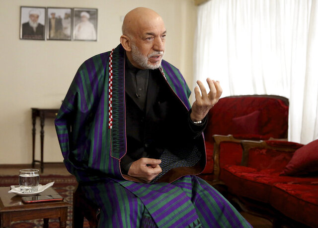 Former Afghan President Hamid Karzai speaks during an interview with The Associated Press in Kabul, Afghanistan, Friday, Feb. 28, 2020. On the eve of a potentially historic deal with the U.S. and the Taliban to end 18 years of war in Afghanistan, former Karzai welcomed the signing of the agreement, thanked Americans for their generosity, but had harsh words for the U.S. government and military.  (AP Photo/Tamana Sarwary)