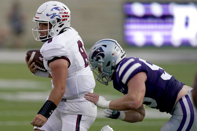 Southern Illinois quarterback Nic Baker (8) is pushed out of bounds by Kansas State linebacker Cody Fletcher (55) during the first half of an NCAA college football game, Saturday, Sept. 11, 2021, in Manhattan, Kan. (AP Photo/Charlie Riedel)