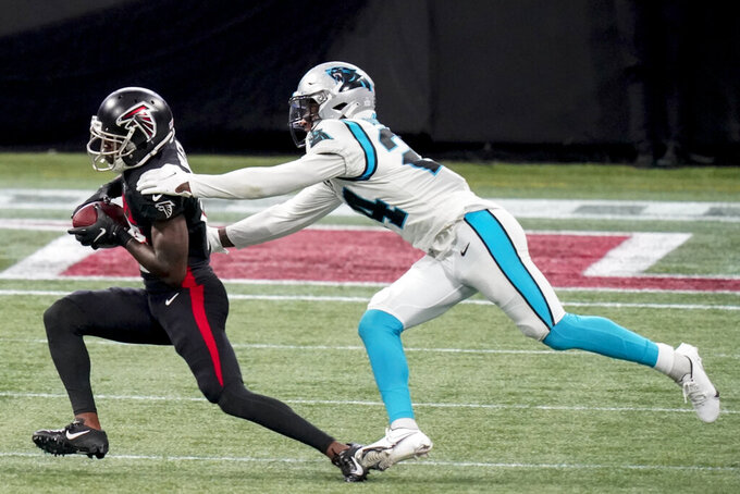 Atlanta Falcons wide receiver Calvin Ridley (18) makes the catch against Carolina Panthers cornerback Rasul Douglas (24) during the second half of an NFL football game, Sunday, Oct. 11, 2020, in Atlanta. (AP Photo/Brynn Anderson)