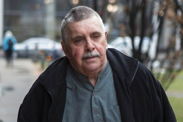 FILE - In this April 22, 2014, file photo, Gordon Stuckless arrives at court in Toronto. Stuckless, the man at the heart of the Maple Leaf Gardens sexual abuse scandal, died Thursday night, April 9, 2020, at a hospital in Hamilton, Ontario, after a brain hemorrhage Tuesday, lawyer Ari Goldkind said. Stuckless was in his early 70s. Stuckless was sentenced in 2016 to 6 1/2 years in prison — six after credit for his time on house arrest — for more than 100 offenses related to the sexual abuse of 18 boys over three decades. He was released to a halfway house on day parole in December. (Chris Young/The Canadian Press via AP, File)
