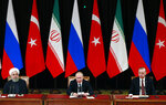 Russian President Vladimir Putin, center, Iranian President Hassan Rouhani, left, and Turkish President Recep Tayyip Erdogan, right attend a news conference after the talks in the Bocharov Ruchei residence in the Black Sea resort of Sochi, Russia, Thursday, Feb. 14, 2019. Putin hosted the leaders of Turkey and Iran for talks about a Syria peace settlement as expectations mount for an imminent and final defeat of the Islamic State group(Presidential Press Service via AP, Pool)