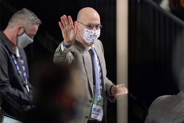 NBA Commissioner Adam Silver waves to Los Angeles Lakers owner Jeanie Buss sitting nearby as he attends Game 2 of basketball's NBA Finals between the Lakers and the Miami Heat on Friday, Oct. 2, 2020, in Lake Buena Vista, Fla. (AP Photo/Mark J. Terrill)