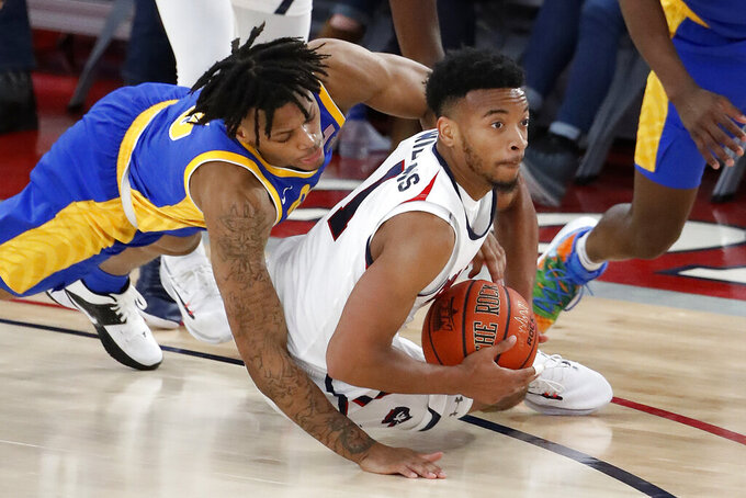 Robert Morris' Jon Williams, right, and Pittsburgh's Justin Champagnie dive for a loose ball during the second half of an NCAA college basketball game in Pittsburgh, Tuesday, Nov. 12, 2019. Pittsburgh won 71-57. (AP Photo/Gene J. Puskar)