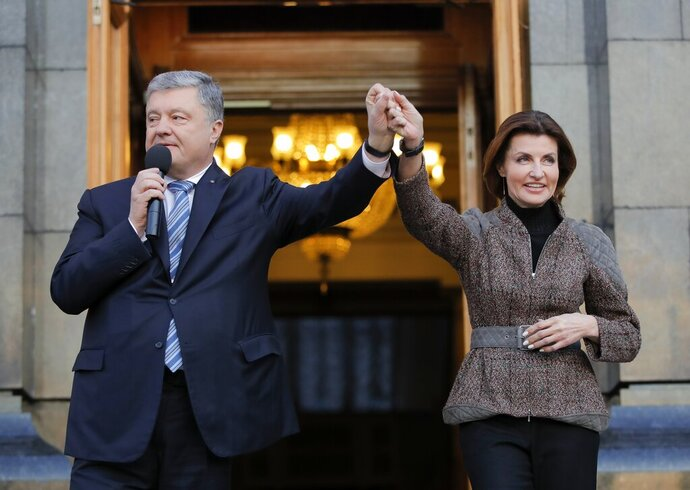 Ukrainian President Petro Poroshenko and his wife Maryna greet their supporters who have come to thank him for what he did as a president, in Kiev, Ukraine, Monday, April 22, 2019. Political mandates don't get much more powerful than the one Ukrainian voters gave comedian Volodymyr Zelenskiy, who as president-elect faces daunting challenges along with an overwhelming directive to produce change. (AP Photo/Vadim Ghirda)