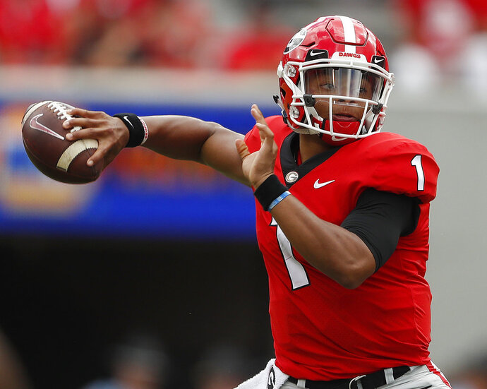 FILE - In this Sept. 15, 2018, file photo, Georgia quarterback Justin Fields (1) throws a pass in the first half of an NCAA college football game against Middle Tennessee, in Athens, Ga. Fields may be getting closer to transferring to Ohio State. Fields, the overall No. 2 national prospect in the 2018 recruiting class, was expected to visit the Ohio State campus on Friday, Jan. 4, 2019, according to a source close to the situation who spoke on the condition of anonymity because no transfer has been finalized. (AP Photo/John Bazemore, File)