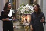 Fiance Tri Novia Septiani, left, and mother Herlina Simbala of Dr. Michael Robert Marampe attend an online memorial service to mark the 40th day since Marampe passed away due to COVID-19 in Jakarta, Indonesia, on June 5, 2020. Marampe knew what he wanted to be since he was a kid: a doctor and a pianist. He became both, and his passion for music even led him to Septiani - a woman he never got to marry because he got the coronavirus. Marampe became one of dozens of doctors the coronavirus has claimed so far in Indonesia. (AP Photo/Tatan Syuflana)
