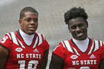 North Carolina State wide receivers C.J. Riley, left, and Emeka Emezie have their picture taken during the team's NCAA college football media day in Raleigh, N.C., Sunday, Aug. 11, 2019. (AP Photo/Gerry Broome)