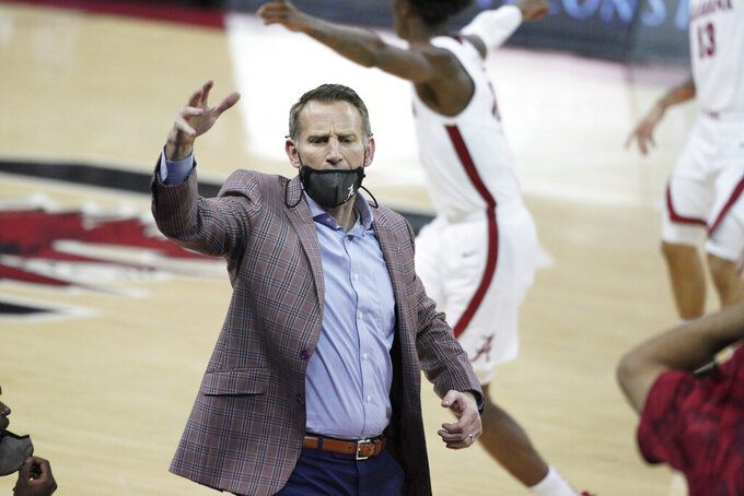 Alabama head coach Nate Oats communicates with players during the first half of an NCAA college basketball game against South Carolina Tuesday, Feb. 9, 2021, in Columbia, S.C. (AP Photo/Sean Rayford)