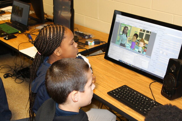 Joe Cook Elementary fifth-graders Dariyah Hill, left, and Easton Sime work on animating characters Tuesday, Dec. 10, 2019, on the Story Maker software platform. With the software, students can voice characters, control their gestures and much more. (Zack Plair/The Commercial Dispatch via AP)