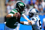 New York Jets quarterback Zach Wilson pushes away Carolina Panthers defensive end Brian Burns during the first half of an NFL football game Sunday, Sept. 12, 2021, in Charlotte, N.C. (AP Photo/Jacob Kupferman)